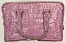 Prada Pink Purple Lady's Crocodile Handbag. Has Original Prada Storage Bag. Signed Prada, Milano. Made in Italy. Wear or else Good Condition. Measures 8-3/4 Inches Tall by 12-1/2 Inches Wide Not Counting Strap. Shipping $30.00