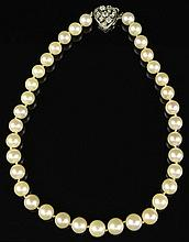 Vintage Single Strand 6mm Pearl Necklace with Diamond and 14 Karat White Gold Figural Heart Clasp and Safety Lock. Unsigned. Heart Clasp with Approximately 0.60 Carats of Brilliant Cut and Old European Cut Diamonds. Good to Very Good Condition.