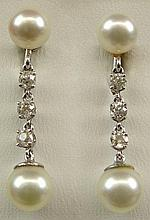 Pair of Vintage Diamond, Pearl 14 Karat White Gold Drop Earrings with Screw Backs. Each Signed 14K Two (2) Times. Earrings Contain Six (6) Diamonds Total Weight .60 Carats. Very Good Condition. Drop Measures 1-3/8 Inches. Shipping $26.00