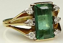 Lady's Vintage Step Emerald Cut Emerald, Round Brilliant Cut Diamond and 18 Karat Yellow Gold Ring. Emerald Measures Approx. 9mm x 4.5mm, VS Clarity with Good Saturation of Color, Diamonds G-H Color, SI Clarity. Signed 750. Good Condition. Ring Size