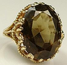 Lady's Vintage Dark Golden Topaz and 14 Karat Yellow Gold Ring. Signed 14K. Topaz Measures Approx. 17mm x 12mm. Topaz VS Clarity. Ring Size 7. Approx. Weight: 4.60 Pennyweights. Shipping $26.00