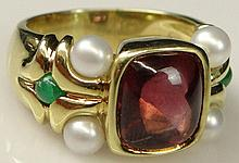 Lady's Antique style Cabachon Rubelite, Emerald, Pearl and 18 Karat Yellow Gold Ring. Signed 18K. Rubelite Measures Approximately 7mm square. Ring Size 6. Good to very Good Condition. Approx. Weight: 7.0 Pennyweights. Shipping $26.00