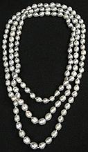 Approximately 144 Count Strand of Gray Rope Length Baroque Pearls Measuring Approximately 87 Inches Long and 8mm to 11mm Diameter. Very Good Overall Condition. Shipping $32.00