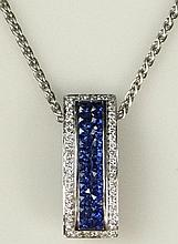 1.72 Carat Invisible Set Sapphire, 0.32 Carat Diamond and 14 Karat White Gold Pendant and Rope Chain. Sapphires with Vivid Blue Saturation of Color, VS Clarity. Chain Signed 14K and Italy. Good to Very Good Condition. Pendant Measures 7/8 Inch Long,