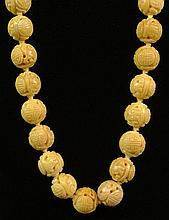 Circa 1930's Chinese Carved Yellow Jade or Hardstone Bead Necklace. Unsigned. Good Condition. Beads Measure 15-1/2mm Diameter. Measures 30-1/2 Inches Long. Approx. Weight: 10.80 Ounces. Shipping $34.00