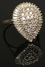 Vintage 58 Diamond and 10 Karat Yellow and White Gold Shield Shape Lady's Ring, Size 7-1/2. Round Brilliant Cut and Baguette Diamonds Weigh Approximately 1.20 Carat. Signed 10K and Hallmark Maker's Mark. Good to Very Good Condition. Weighs 6.2 Grams