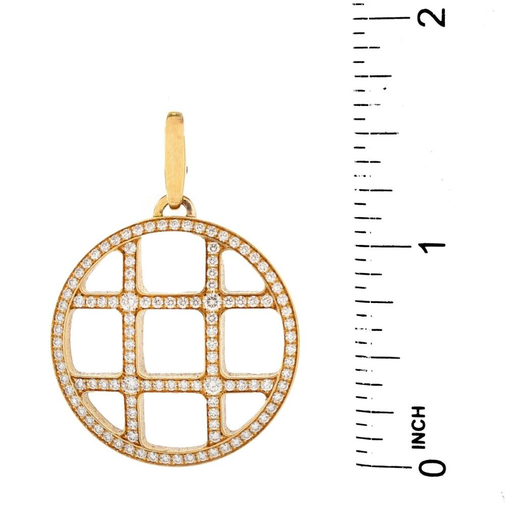 Lot 13: Vintage Cartier Diamond and 18K Pendant