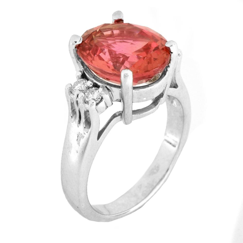 6.60ct. Oval Cut Orange Sapphire and 14K Gold Ring