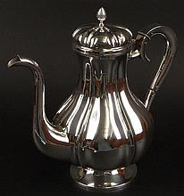 Early 20th Century Latvian Silver Ribbed Coffee Pot. Hinged Lid with Pineapple Finial. Hebrew Monogram on Handle. Signed on Bottom with Latvian Hallmark 875. Good Condition Measures 10-1/2 Inches Tall and Weighs 28.65 Troy Ounces. Shipping $69.00