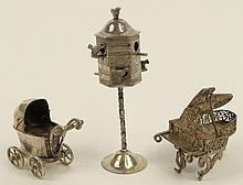 Lot of Three (3) Antique Silver Miniatures. The Group Consists of a Bird Feeder, 3-5/8 Inches Tall; Baby Buggy with Moveable Wheels, 1-5/8 Inches Tall; Filigree Grand Piano, 2 Inches Tall. Total Weight 2.30 Troy Ounces. Unsigned. Good Condition.