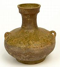 Han Dynasty (206 BCE-220 BC) Small Earthenware Hu Vessel with Lug Handles. Surface Wear and Cracks Consistent with Age Otherwise in Good Condition. Measures 4-1/4 Inches Tall, 5 Inches Wide. The Gallery Has Been Advised Provenance: ex-Shepps