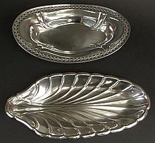 Reed and Barton Shell Shaped Sterling Silver Serving Dish, along with a Reticulated Sterling Silver Bread Server, signed MH STERLING. The Reed and Barton piece Measures 12-1/2 Inches Long, 5-3/4 Inches Width. The Bread Tray measures 11 Inches Length,