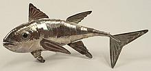 Vintage Peruvian Sterling Silver Flexible Fish Figurine. The Eyes Inset with Green Gem Stone or Glass. Signed on Tail Peru 925. Minor Bends or in Otherwise Good Condition. Measures 5-3/4 Inches Tall, 14 Inches Length and weighs 11.58 Troy Ounces.