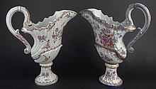 Two (2) French Samson Porcelain Ewers with Painted Floral Decoration and Coats of Arms. Marked to bases. Minor Rubbing to Gilt Decoration Otherwise Good Condition or Better. Measure 12-1/8 Inches Tall and 10 Inches Wide. Shipping $64.00
