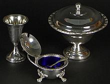 Three (3) Pieces Miscellaneous Sterling Silver Table Top Items. This lot includes a Small Weighted Covered Compote, Measuring 4 Inches Tall; A Hinged Covered Salt With Cobalt Glass Liner, Measures 2-1/2 Inches Tall, A chased Kidduch Cup, Measuring 4