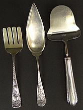 Three (3) Miscellaneous Sterling Silver Serving Pieces. 1 Rustfri Norway Cheese Slicer 8-5/8 Inches Long. 1 Carter Brothers Serving Fork 6-3/4 Inches. 1 A. Stowell Serving Slice. Weighs 3.240 Troy Ounces Total with Stainless Steel Cheese Slice.