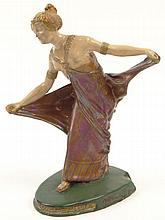 BACS, Golfe-Juan Art Deco Pottery Dancing Lady Figure with Luster Glaze. Impressed Mark to Base, Artist Signed M. Alexandre and Bacs Mark to Base. Minor Chips to Base Otherwise Good Condition. 7-3/8 Inches Tall and 5-7/8 Inches Wide. Shipping $42.00