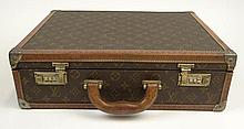 Vintage Louis Vuitton Monogram Hardside Canvas Attaché Case with Cowhide Trim. Signed. Surface Wear from Normal Use Otherwise Good Condition. Measures 17 Inches Long and 13 Inches Wide. Shipping $65.00