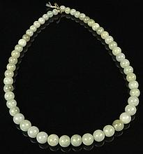 Chinese Carved Pale Celadon Jade Graduated Bead Necklace. Unsigned. Lacking Part of Clasp Otherwise Good Condition or Better. Beads Range from 7mm to 10mm, Necklace Measures 17-1/2 Inches Long. Shipping $34.00