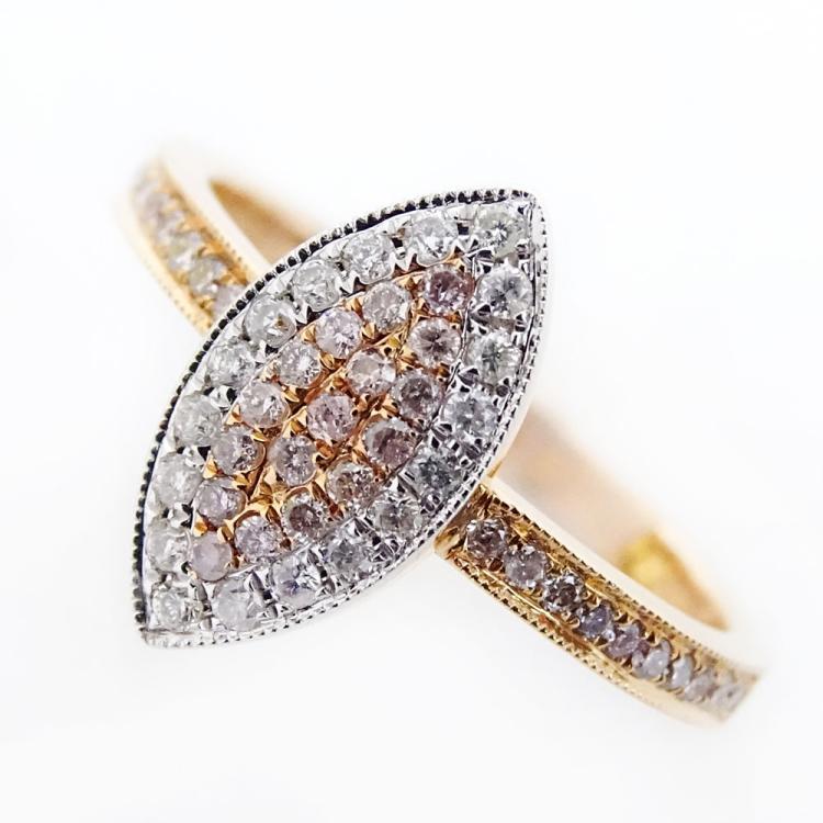 .23 Carat Round Cut Natural Pink Diamond, .14 Carat Round Cut Diamond and 18 Karat Rose Gold Ring