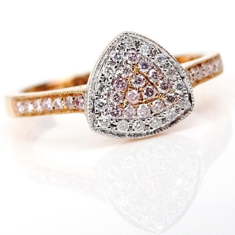 .19 Carat Round Cut Natural Pink Diamond, .08 Carat Round Cut Diamond and 18 Karat Rose Gold Ring