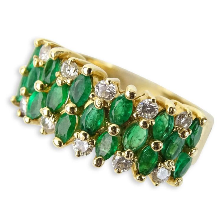 Vintage Oval Cut Emerald, Round Brilliant Cut Diamond and 14 Karat Yellow Gold Ring