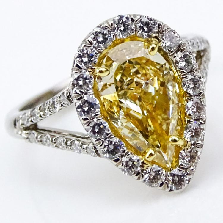 EGL Certified 2.01 Carat Pear Shape Fancy Intense Yellow Diamond and Platinum Ring accented with .71 Carat Round Brilliant Cut Diamonds