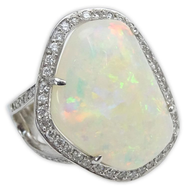 Large White Opal, Round Brilliant Cut Diamond, Blue Diamond and 18 Karat White Gold Ring