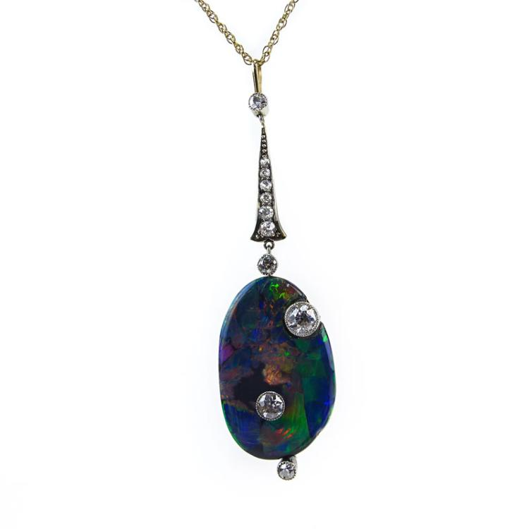 Art Nouveau Australian Free Formed Black Opal, European Cut Diamond, Platinum and 14 Karat Yellow Gold Pendant with 14 Karat Yellow Gold Chain
