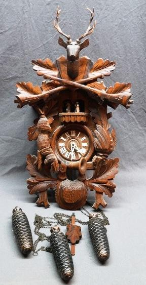 Black Forest Cuckoo Clock with Carved Hunting Decorations- with Weights