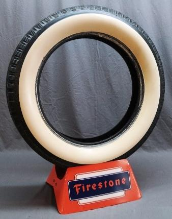 Firestone Tires Display Stand in Orange and Blue with White Wall Tire
