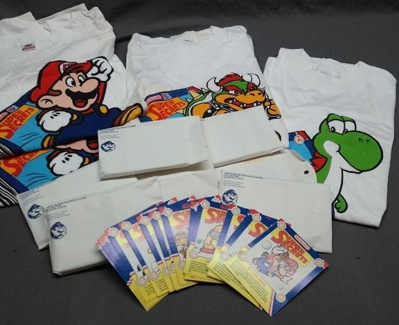 Lot of 1991 Pepsi Nintendo Promotional Tee Shirts and Super Mario Secrets Cards