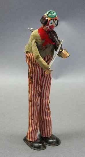 Wind Up Violin Playing Clown Hobo on Stilts