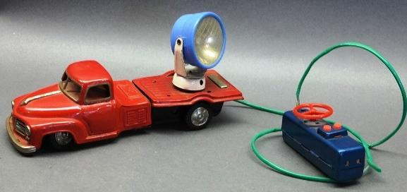 Battery Operated Remote Control and Friction Searchlight Truck
