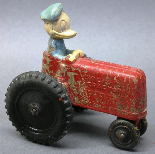 Donald Duck Driving Mickey's Tractor Sun Rubber Toy