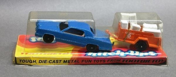 Tootise Toy Hitch Ups Sedan with U-Haul Trailer in Original Package-