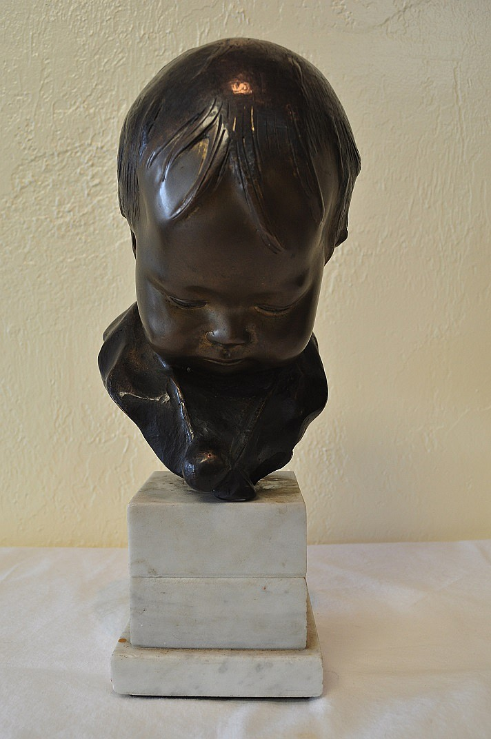 Child Bronze bust on marble base Signed