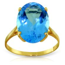 14K. SOLID GOLD RING WITH NATURAL OVAL BLUE TOPAZ