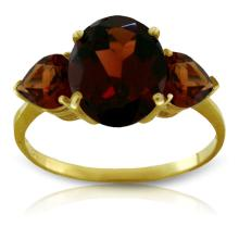 14K. SOLID GOLD RING WITH NATURAL GARNETS