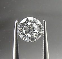 GIA CERT. 0.57 CTW ROUND DIAMOND D/SI1