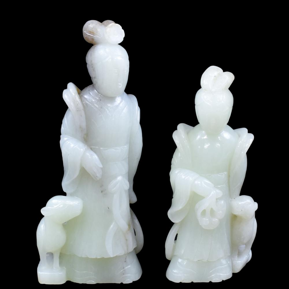 PAIR OF CARVED WHITE JADE OF FEMALE FIGURES