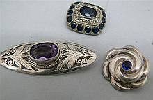 3 precipitated older silver brooches