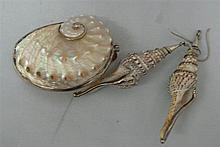 very unusual jewelery made of shells