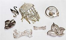 small lot of 7 silver brooches, various designs