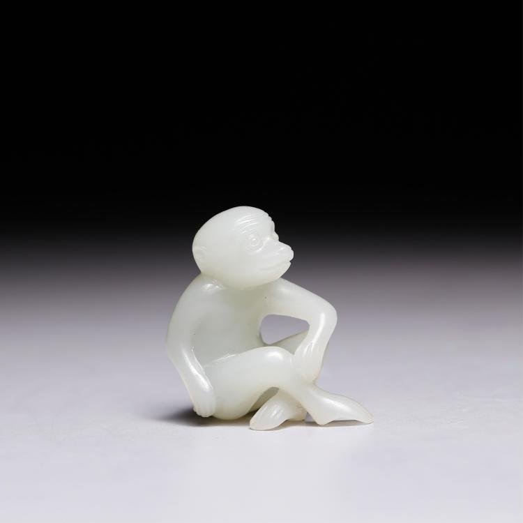 CHINESE WHITE JADE FIGURE OF A MONKEY