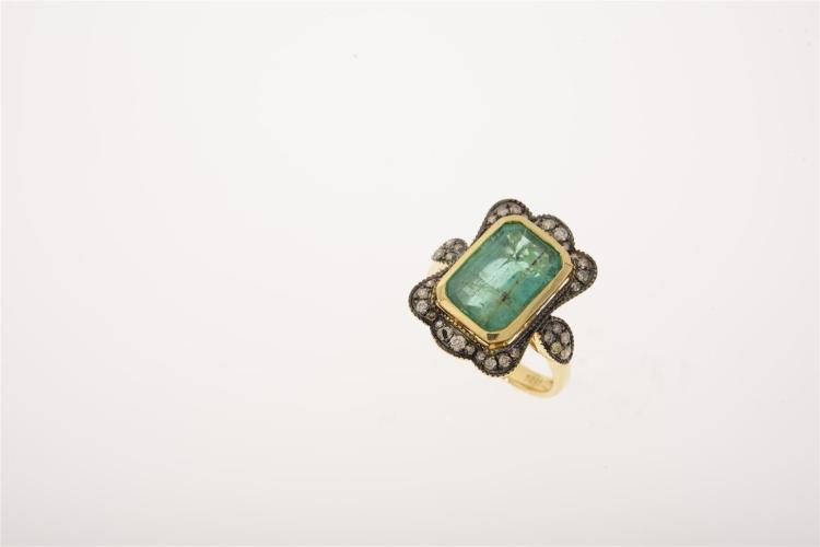 an emerald and dress ring