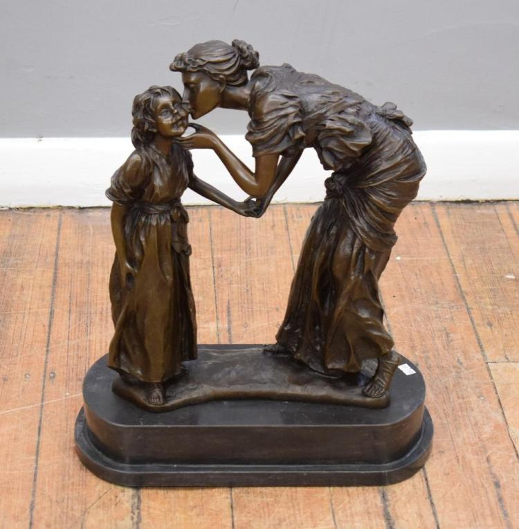 A BRONZE OF A MOTHER AND SON