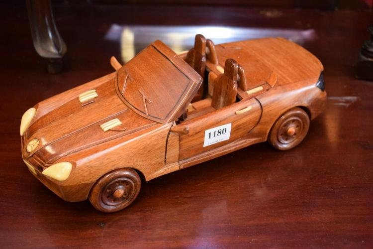 A TIMBER MODEL OF A MERCEDES BENZ