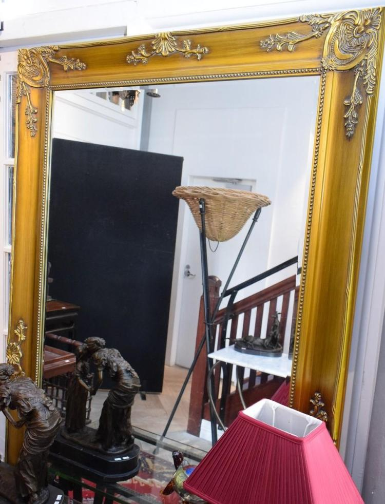 A LARGE DECORATIVE GILT FINISHED MIRROR