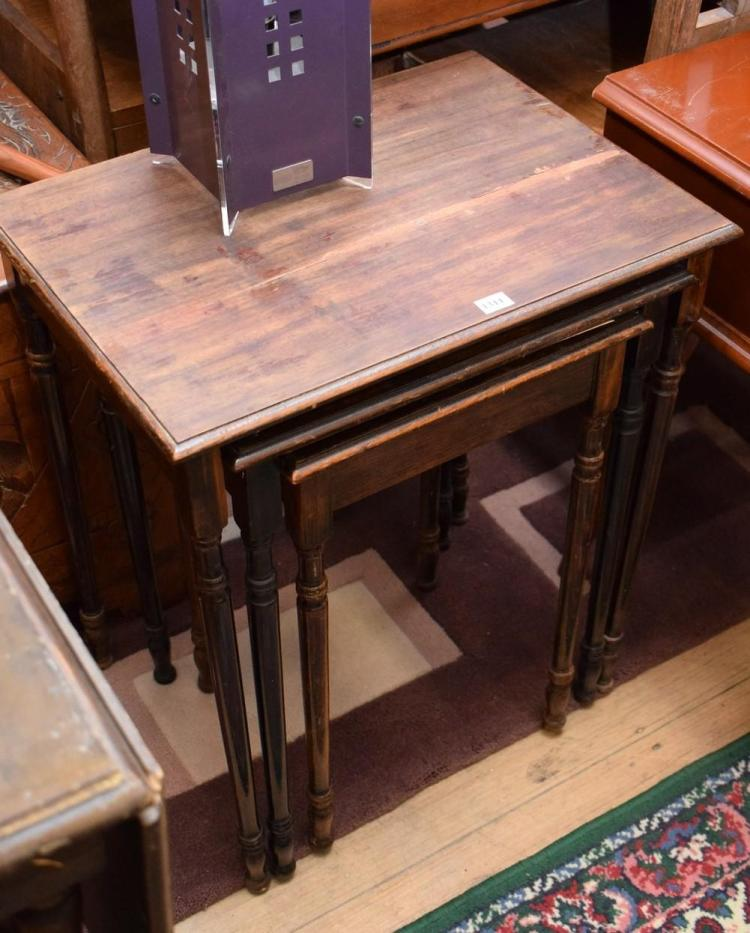 AN EARLY 20TH CENTURY NEST OF TABLES